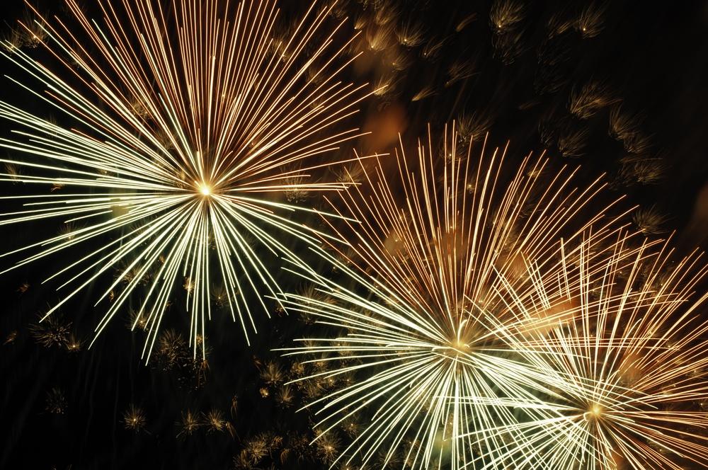 Three bursts of fireworks in proximity